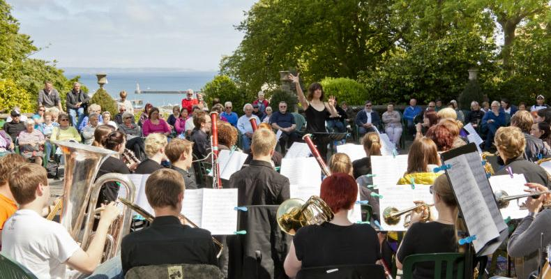 Orchestra playing outside in Candie Gardens in St Peter Port