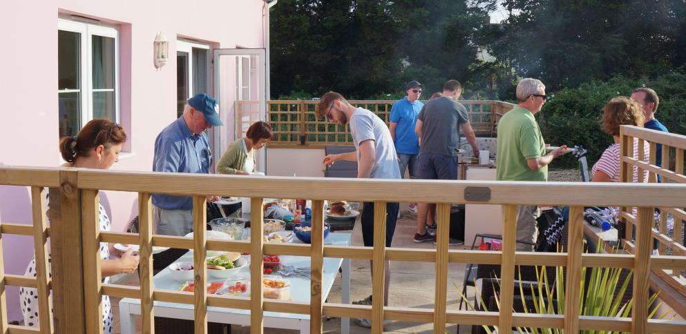 Holiday guests enjoying a BBQ on the terrace