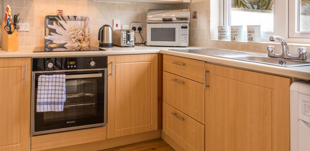 Fully equipped kitchen in a two bedroom holiday rental at The Ellingham Cottages in Guernsey