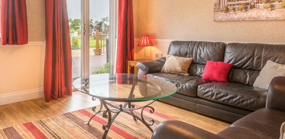 The living room in the ground floor two bedroom cottage suitable for disabled access