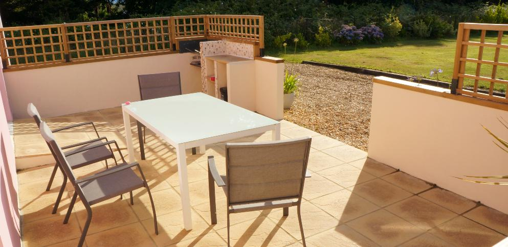 Terrace with seating area overlooking back garden