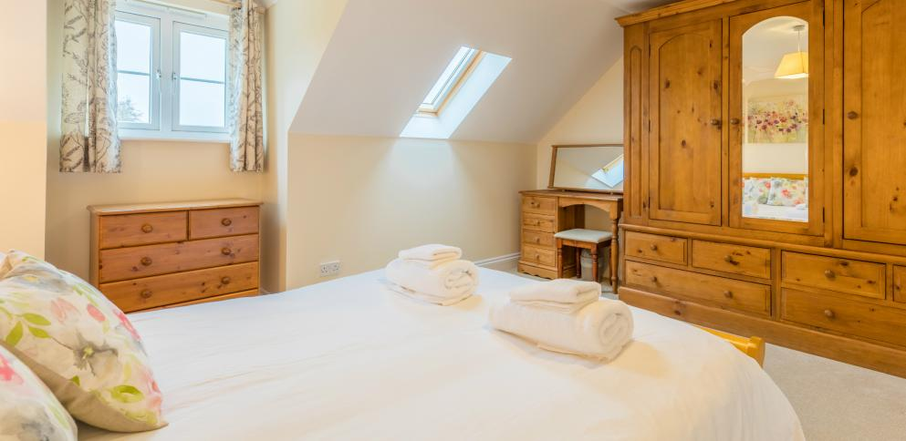 master bedroom in three bedroom apartment at The Ellingham Cottages