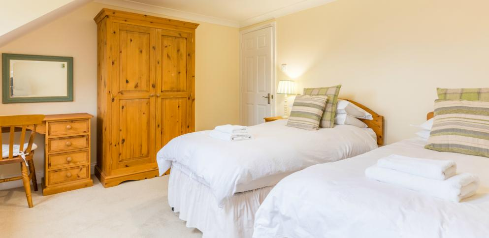 Twin room at the back of the 3 bedroom apartment at The Ellingham Cottages