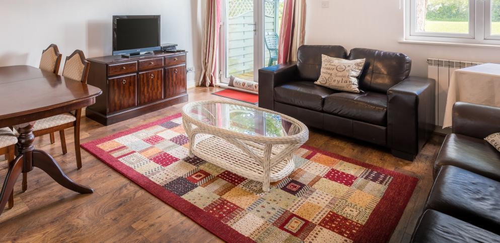 The living room has an outdoor area in this two bedroom holiday rental in Guernsey