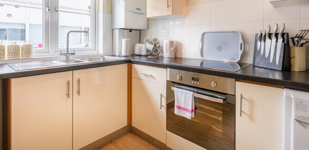 A cream kitchen with new units in this two bedroom holiday cottage