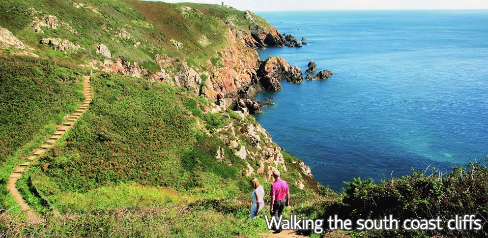 Couple walking the south coast cliffs of Guernsey
