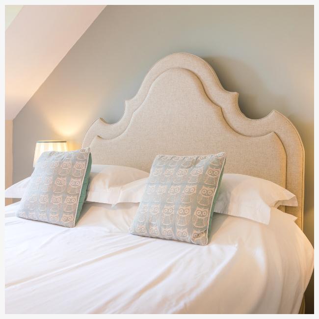 curved headboard in master bedroom at The Ellingham Cottages, St Martins, Guernsey