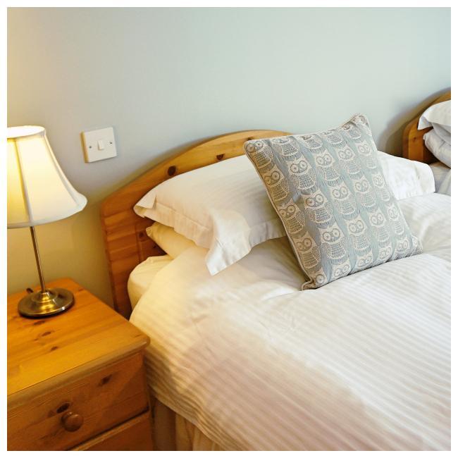 Bed in twin bedroom at The Ellingham Cottages, St Martins, Guernsey