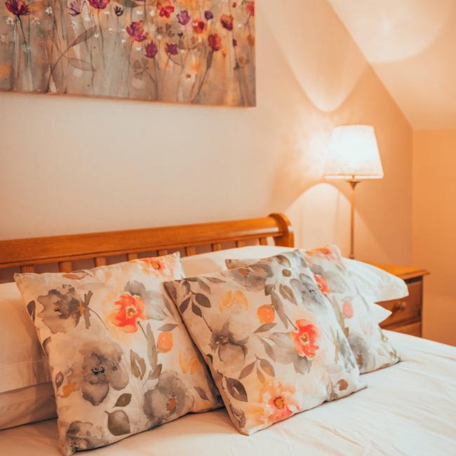 detail photo of the master bedroom in the 3 bedroom apartment at The Ellingham Cottages