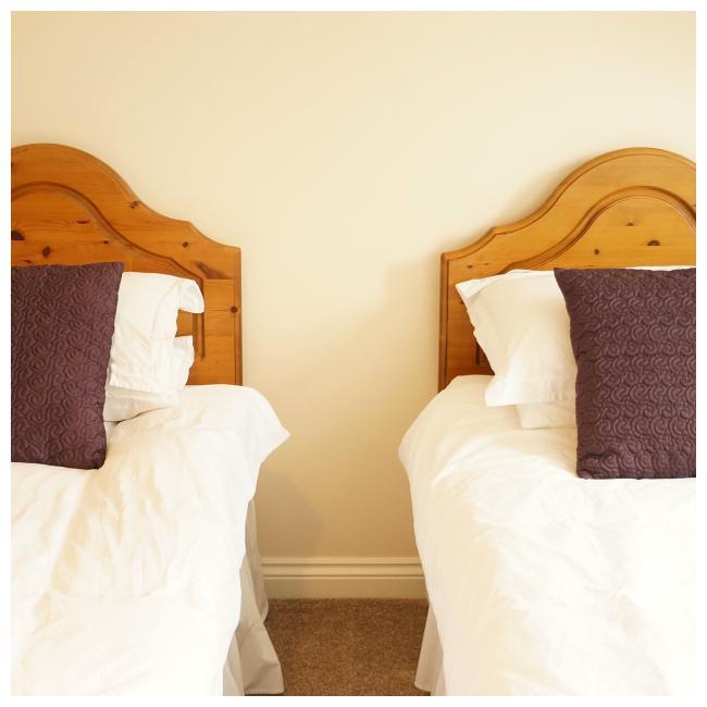 side shot of two single beds in The Ellingham Cottages, St Martins, Guernsey