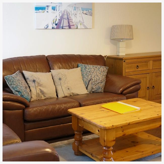 Living room sofas in The Ellingham Cottages, St Martins, Guernsey