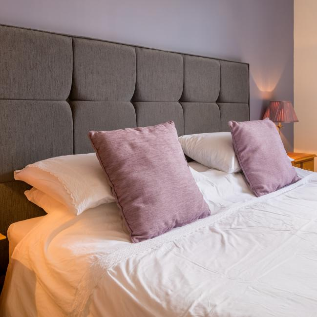 Large bed in the three bedroom cottage holiday rental at The Ellingham Cottages, ideal for families and groups