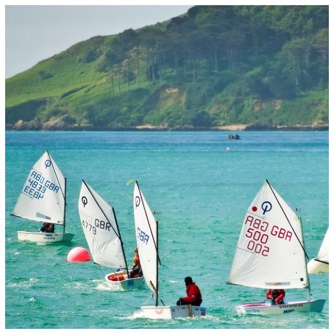 Children sailing in Havelet Bay