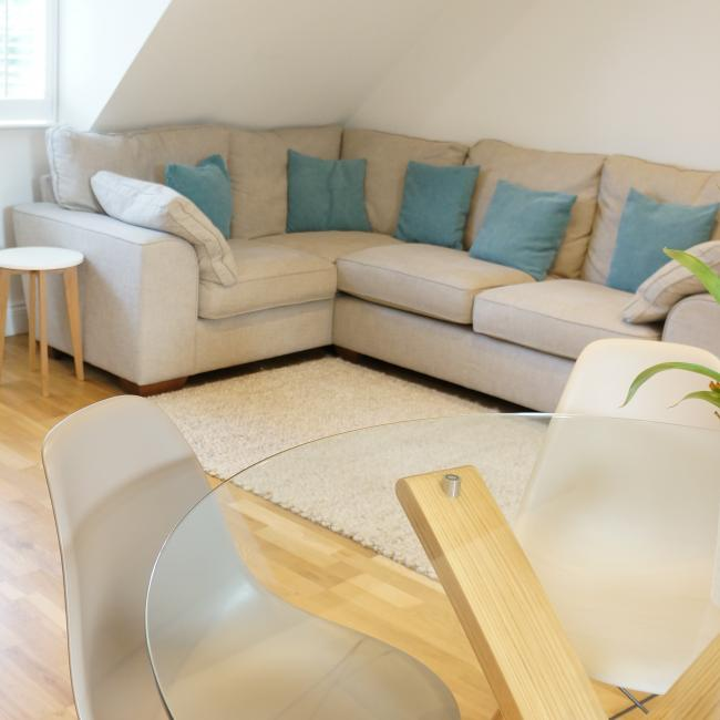 open plan living room, view of table and sofa
