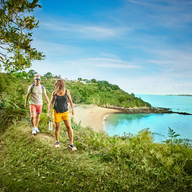 couple walking on the south coast in Guernsey